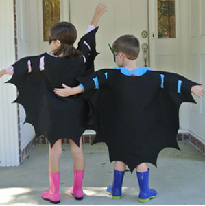 kids in black bat wing shaped capes