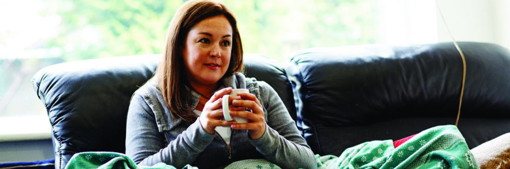 woman with tea on couch