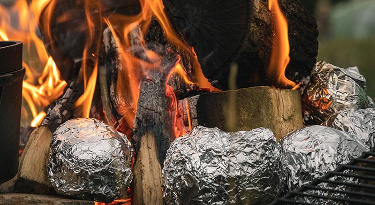 baked potatoes on bonfire