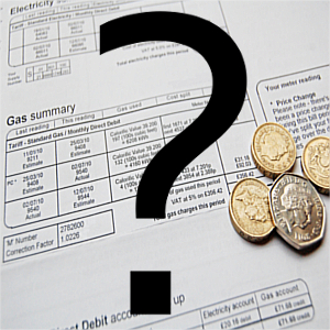 electricity bill with coins on top and a large question mark