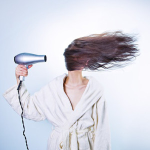 hair dryer drying girl's hair