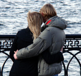 Hugging couple on a windy day