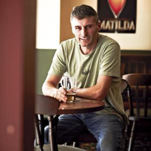 Man having a drink in a pub