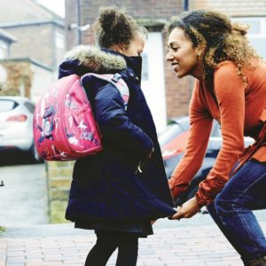mum and daughter on way to school