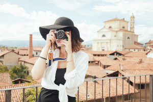 lady taking photograph on holiday