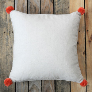 Plain pillow with pom pom corners