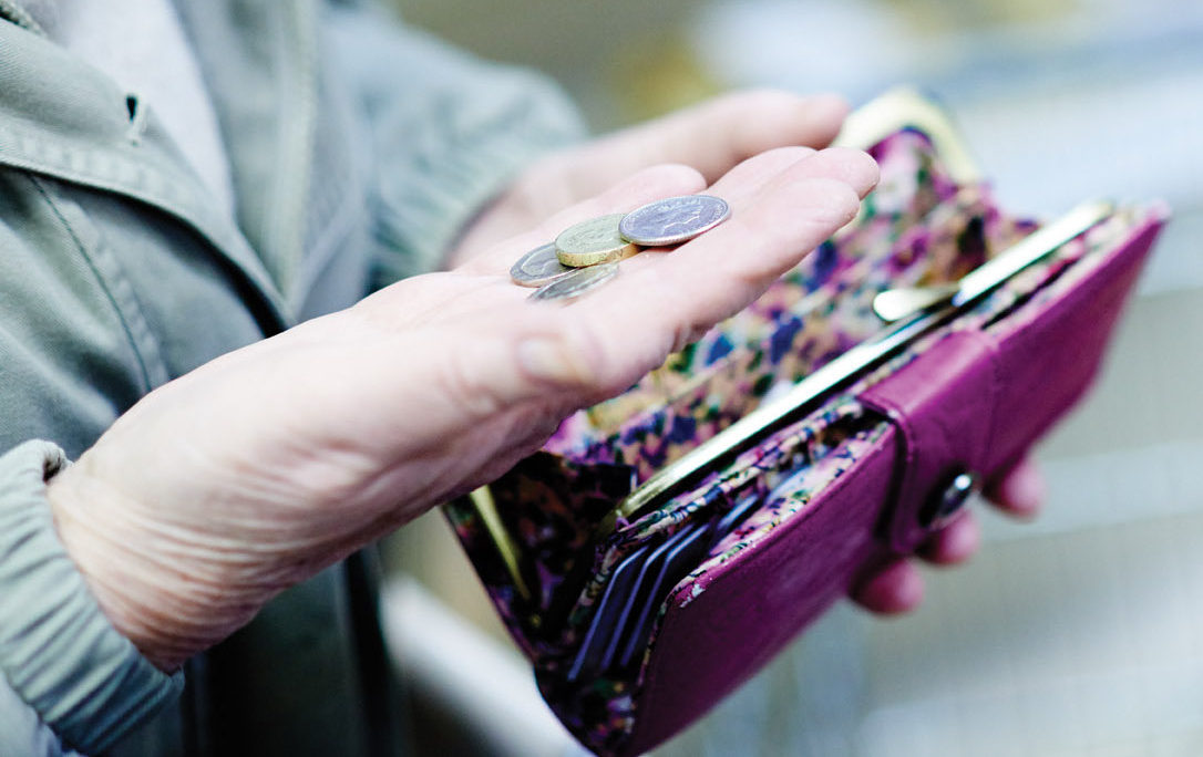 Lady taking coins out of purse