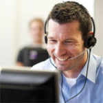 Man in call centre at computer