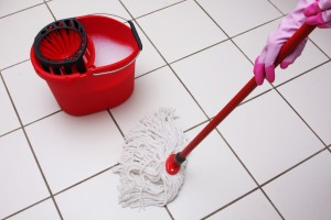 mop and bucket on tiled floor