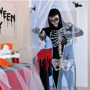 person dressed in skeleton costume