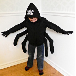 child dressed in a homemade spider costume